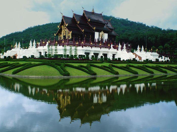 Royal pavilion reflecting in lake at chiang mai province