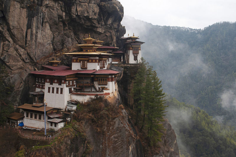 Panoramic view of buildings against mountains