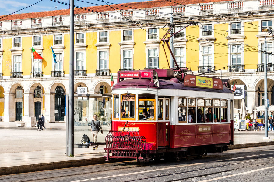 Red tram on the streets of Lisbon, Portugal Lisbon - Portugal Lisbon Tram Lisbon City Life Lisbon Streets Lisbon Trams Lisbon, Portugal Red Tram Tram Tram Cars Tram Stop Transportation Architecture Building Exterior Built Structure City Life Lisbon Mode Of Transportation Public Transportation Rail Transportation Railroad Track Track Tram Lines Tram Tracks Tram Travel Transportation