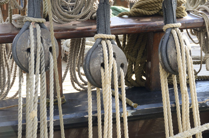 Ropes tied to pulley in ship