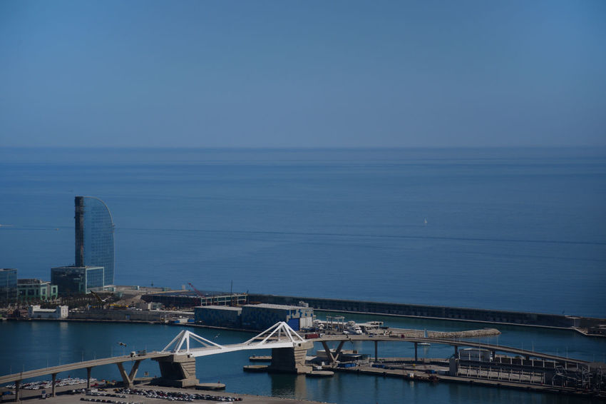 Barcelona's port in the Mediterranean sea Architecture Blue Bridge Building Exterior Built Structure City Clear Sky Harbor Horizon Over Water Mode Of Transportation Nautical Vessel No People Outdoors Sea Sky Skyscraper Transportation Travel Destinations Water