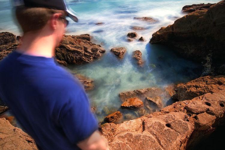 Rear view of man at sea shore