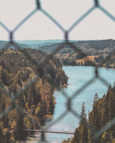 A dream view🌲🏞 Landscape Trollhättan EyeEm Selects Water Fence Nature Sky Boundary Barrier No People Plant Scenics - Nature Tree Sea Focus On Background Horizon Over Water Bridge Sunlight Day Summer Road Tripping EyeEmNewHere
