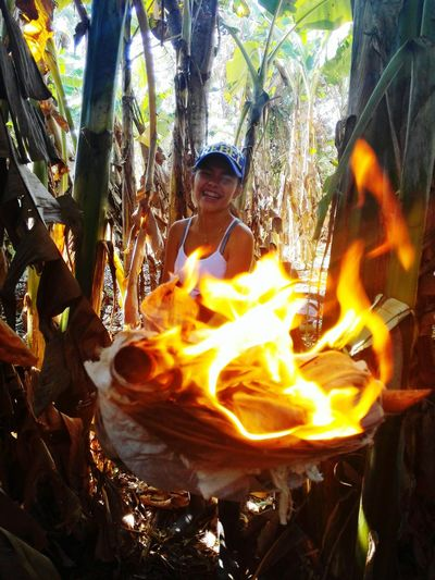 Fire Flame Burning Heat - Temperature Outdoors Day People Tree Nature One Person Adult Adults Only Uniqueness