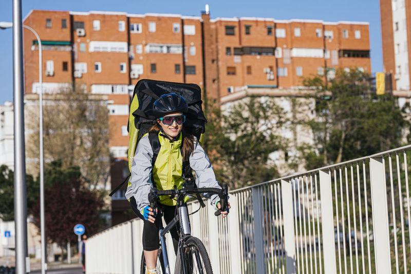 Man riding bicycle on railing