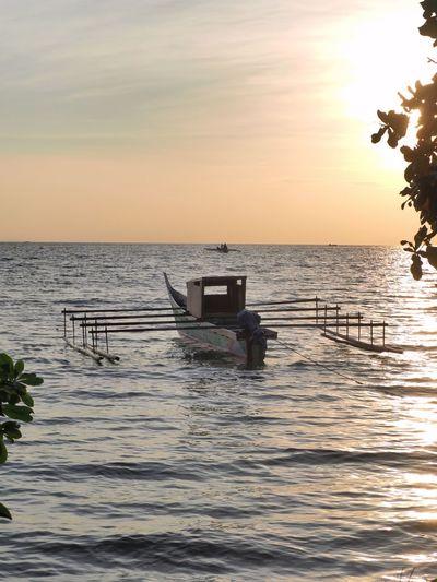 floating undet sunset, Biak Numfor Silhouette Water Nautical Vessel Sun