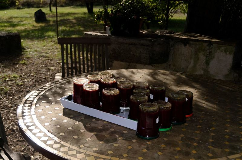 Homemade jam No People Day Nature Outdoors Sunlight Table Plant Focus On Foreground Close-up Pattern High Angle View Front Or Back Yard Container Food And Drink Business Park Drink Tree Homemade Homemade Food Jam Tasty Delicious