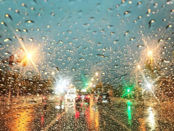 Close-Up Of Wet Window During Rainy Season