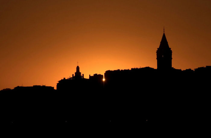 Siluet Silhouette Sky Architecture Travel Destinations Galata Tower Sunrise No People City City Skyline Cityscape Silhouette Built Structure Sunset Tower Tree Building Exterior Clock Tower Outdoors Cultures
