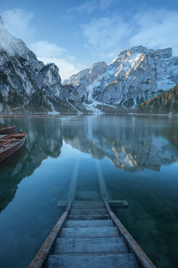 Beautiful lake in the italian alps, Lago di Braies Dolomites, Italy Alps Beauty In Nature Boat Cold Temperature Colorful Day Frozen Idyllic Lago Di Braies Lake Landscape Mountain Nature No People Outdoors Pragserwildsee Reflection Scenics Sky Snow Tranquil Scene Tranquility Water Winter