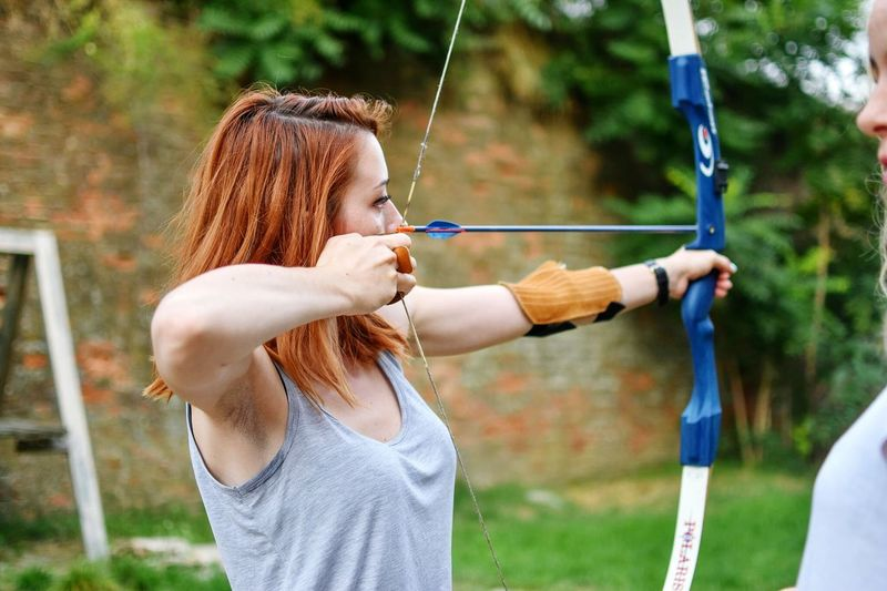 Close-Up Of Woman Practicing Archery
