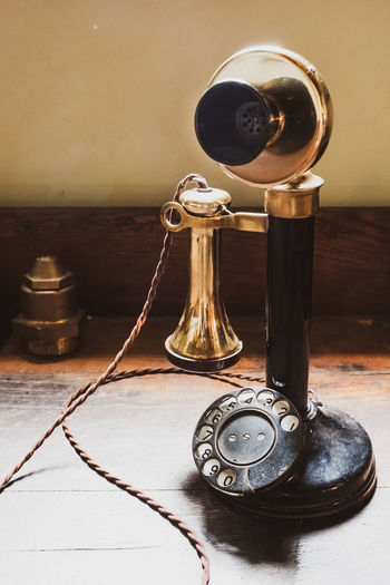 Old rotary phone on table