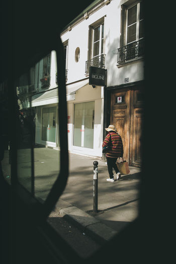 Framing a subject on the street. Photography EyeEm Best Shots Portrait Portrait Of A Woman Visual Creativity Streetphotography Framing Old Full Length Shadow Architecture Closed Door