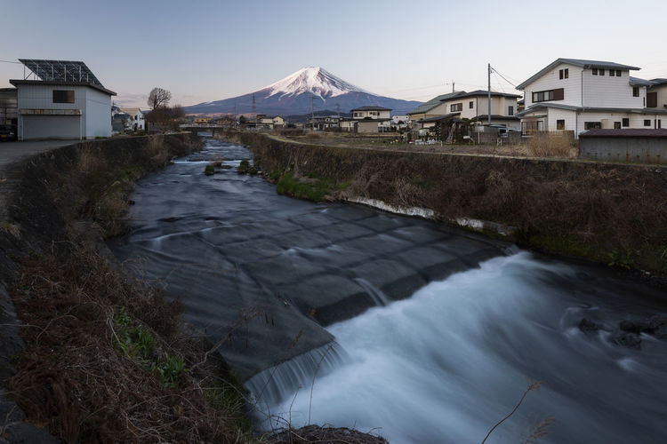 Mount Fuji and Water Stream in a small village, Japan Yamanashi White Water Volcano Village View Vacation Travel Town Tourism Sunset Sunrise Summer Stream Spring Snow Sky Season  Scenic Scenery Scene River Peak Outdoor No People Nature Natural Mt Fuji Mountains Mountain Mount Motion Morning Landscape Landmark Japanese  Japan Holiday Grass Fuji Fresh Evening Dusk Destinations Dawn Blue Beauty Beautiful Background ASIA
