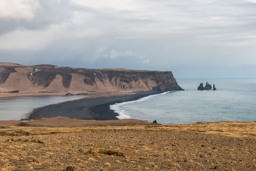 Dyrhólaey Iceland Beach Beauty In Nature Cliff Cloud - Sky Day Dramatic Landscape Land Nature No People Outdoors Reynisdrangar Rock Rock - Object Rock Formation Rocks Scenics - Nature Sea Sky Solid Stack Rock Tranquil Scene Tranquility Water