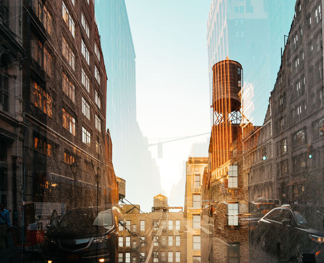 Double Exposure Of Buildings And Cars