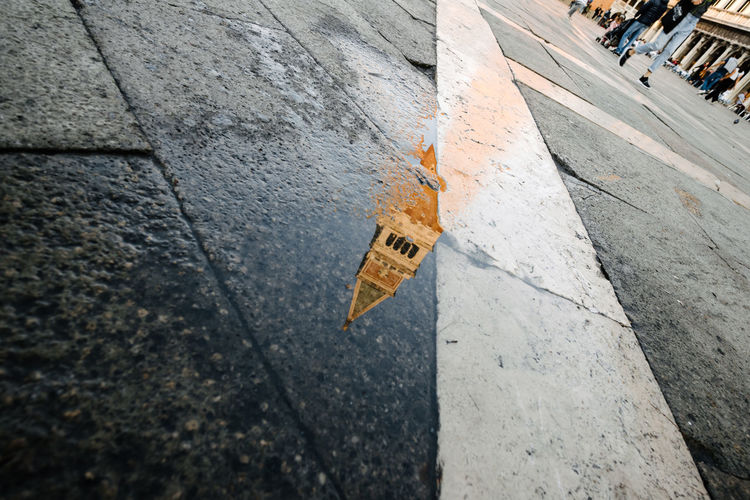 Reflection of st marks campanile on wet street