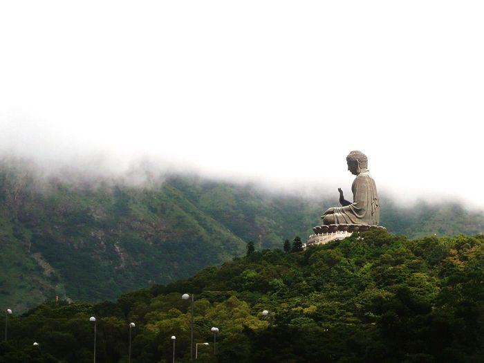 Buddha Statue Against Mountains