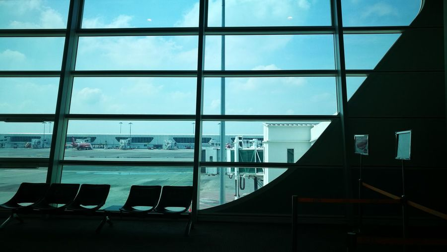 City Airport Airport Departure Area Window Sky Architecture Built Structure Transportation Building - Type Of Building Airport Terminal Arrival Departure Board Airport Check-in Counter Airport Runway Airplane Ticket Public Transportation