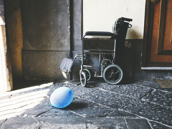 Two objects, a whole life. A portrait of fortitude Baloon Colors Disability  Fortitude Inability Lifetime Portrait Weelchair WILLPOWER