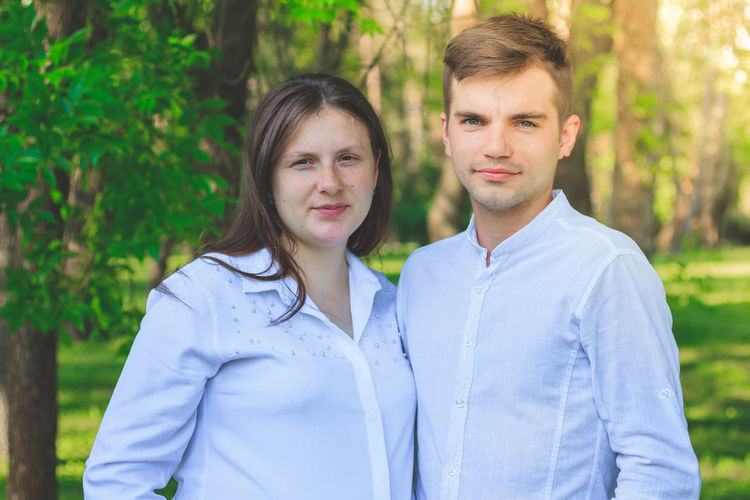 Portrait Of Young Couple Standing At Park