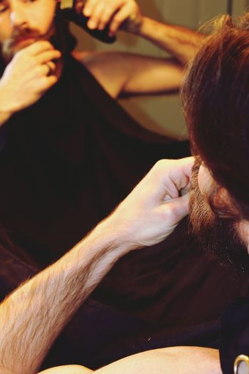 Close-up of bearded man shaving at home