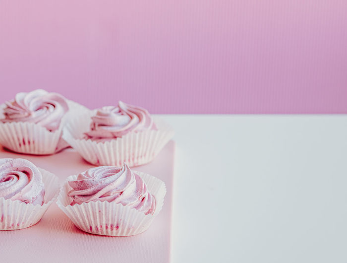 Close-up of cupcakes on table against white background