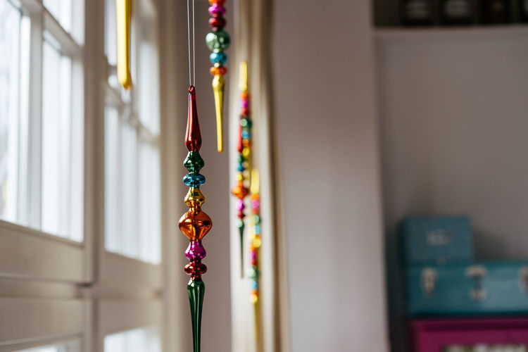 Christmas Decoration Christmas Decoration Christmas Festive Decoration Multi Colored Indoors  No People Selective Focus Focus On Foreground Hanging Close-up Necklace Creativity Jewelry Craft Bead Still Life Art And Craft Aspirations Celebration Day Wall - Building Feature Personal Accessory