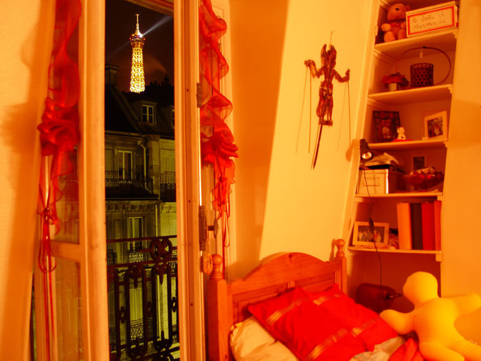 Eiffel Tower view from room in a typical Paris apartment. Appartment Eiffel Tower Night View Paris Paris ❤ Real State Room Window View