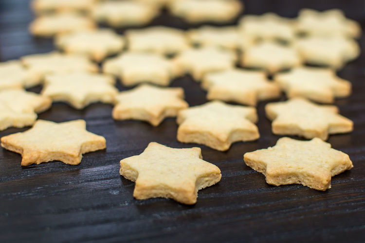 backing stars for christmas time. Cookies. Christmas Christmas Time Advent Season Bake Baked Bakery Baking Sheet Celebration Christmas Cookie Food Food And Drink Freshness Home Made Star Shape Sweet Food