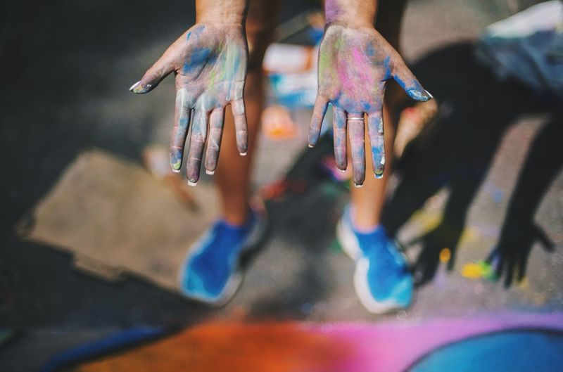 High angle view of human palm with holi colors