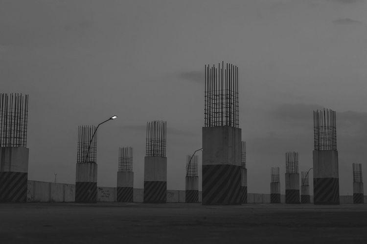 Scaffolding on columns against sky