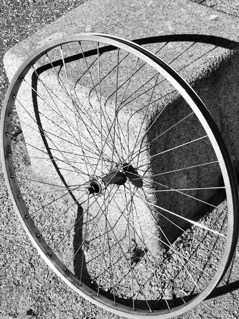 spoke, bicycle, outdoors, day, high angle view, no people, close-up