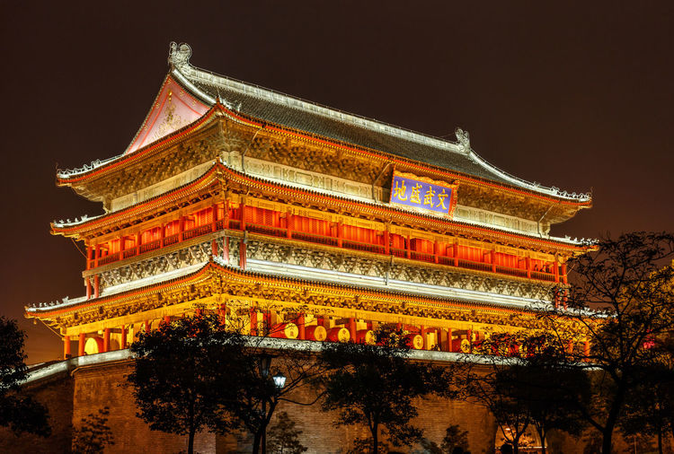 The drum tower in Xi'An at night Drum Drum Tower Xi'an Xi'an Drum Tower Xian Architecture Building Exterior Built Structure City Cultures Dragon Eaves History Illuminated Landmark Night Nightscape Nightshot No People Outdoors Roof Sky Tradition Traditional Tree