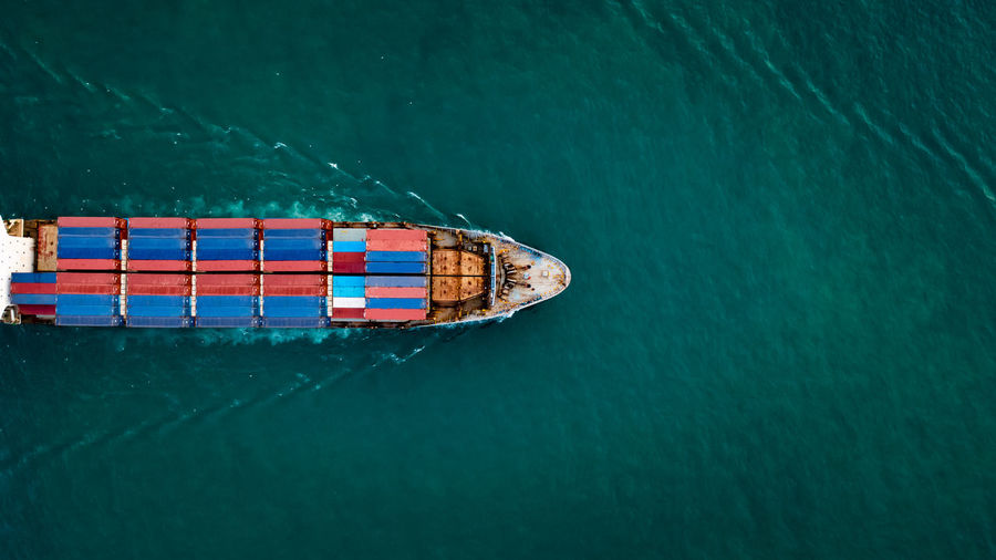 Aerial top view container cargo ship in import export business services commercial