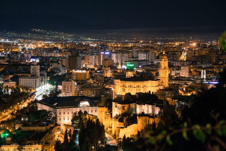 High angle view of illuminated buildings in málaga city at night