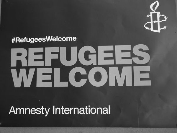 Welcome Amnesty International Close-up Communication Guidance Immigration Reform Information Low Angle View No People Powerful Message Text Western Script