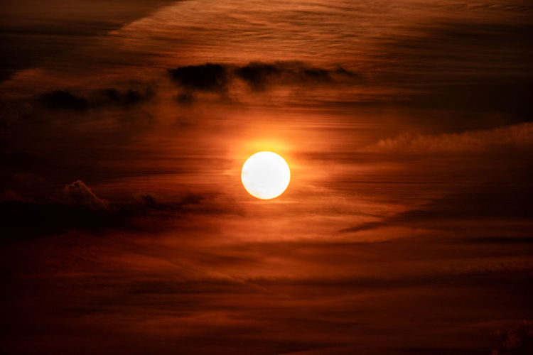 Sky Beauty In Nature Scenics - Nature Cloud - Sky Sunset Tranquil Scene Sun Orange Color Tranquility Geometric Shape Circle Shape Nature Idyllic Astronomy Space No People Sunlight Outdoors Dramatic Sky Moonlight
