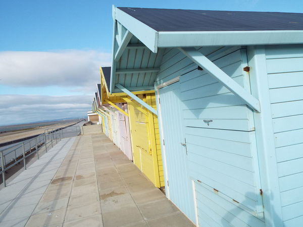 Beach Huts Pastel Power Pastel Colours Huts Row Of Beach Huts Summer2016 Summertime Summer The Essence Of Summer Railing Blue Sky And Clouds Fleetwood Beach Beach Miles Away