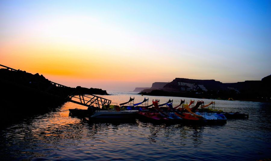 Beauty In Nature Clear Sky Day Mode Of Transport Moored Nature Nautical Vessel No People Outdoors Reflection Scenics Sea Silhouette Sky Sunset Transportation Water Waterfront