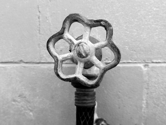 Close-up Day Focus Object Metal Outdoors Maximum Closeness Up Close And Personal Blackandwhite Water Spigot Shapes Shapes And Forms Pattern Pieces Lines Wall - Building Feature Water Random Acts Of Photography Hose Water Faucet House Feature Building Exterior Light And Shadow Focus On Foreground Darkness And Light Water Hose Beauty In Ordinary Things