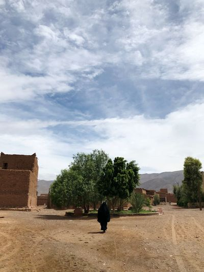 She's real Followme Remote Places Kasbah Black Dress Moroccan Woman Woman Burka  Cloud - Sky Sky Real People Tree Plant Architecture Nature Walking