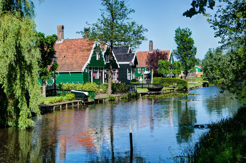 Nederland Zaanse Schans Zaanse Schans Postcards Architecture Beauty In Nature Building Exterior Built Structure Day Holland Holland❤ Lake Nature No People Outdoors Reflection Sky Tranquility Tree Water Watermill