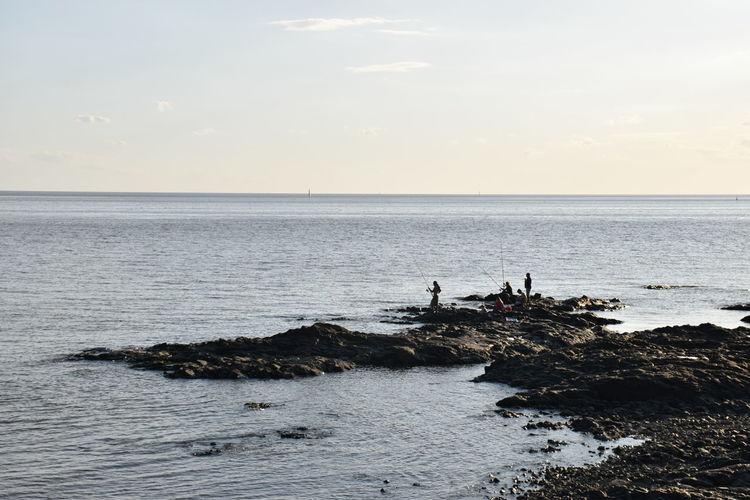Family Fishing Horizon Over Water Idyllic Lifestyles Non-urban Scene Ocean Outdoors Rippled Rocks And Water Scenics Sea Seascape Water