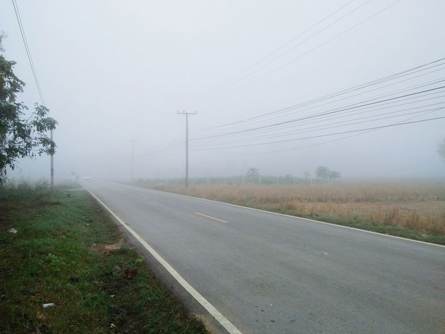 Fog Social Issues Weather Road No People Storm Cloud Accidents And Disasters Extreme Weather Outdoors Landscape Day Photography Themes Beauty In Nature Nature Telephone Line Sky Nature Trees And Nature Roadway Traveling Car On The Road