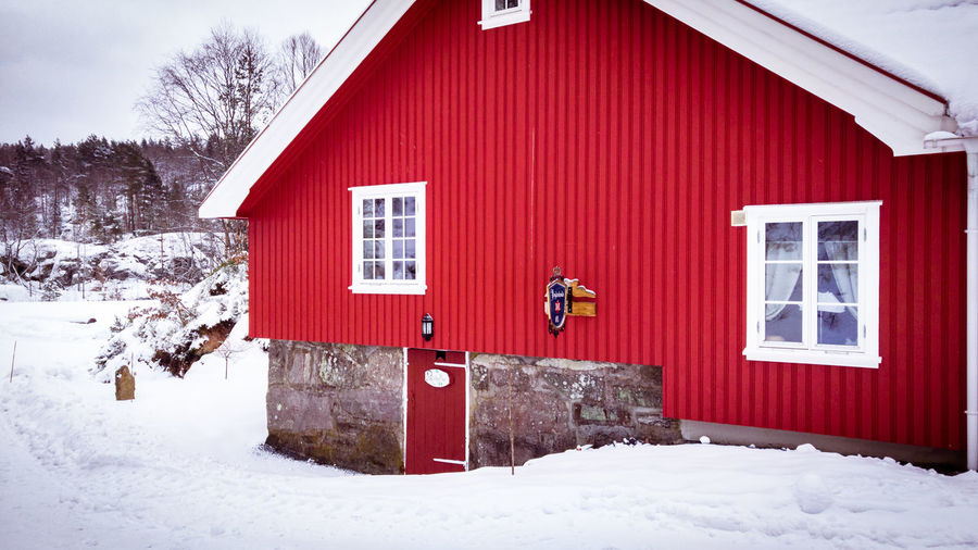 Red house on snow covered building
