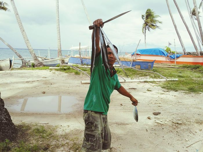 A fisherman in Siquijor, Philippines,showing the catch of the day.Outdoors Nature Sea Essence Jobs Person First Eyeem Photo