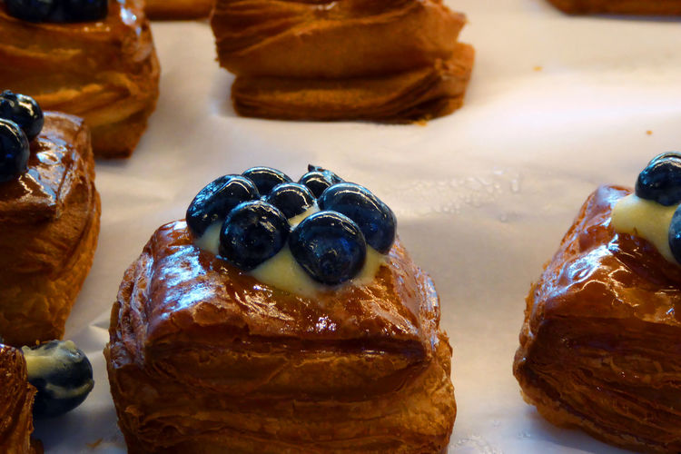 High angle view of blueberries on pastries at store