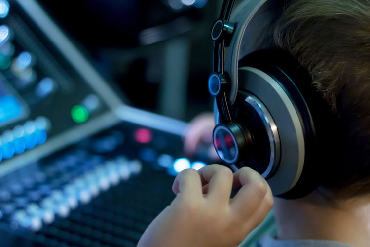 One Person Close-up Technology Music Headphones Boys Child Sound Mixer Sound Mixing Audio Equipment Listening Recording Studio Sound Mixer Controller Dj Club Dj