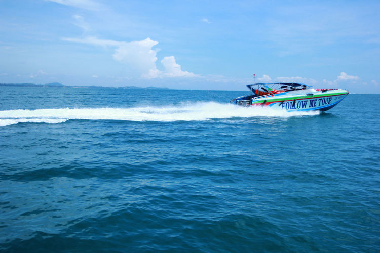 Sea Nautical Vessel Transportation Mode Of Transportation Water Motion Waterfront Speed on the move Day Nature Motorboat Beauty In Nature Sky Travel Sailing Scenics - Nature Speedboat Outdoors Passenger Craft